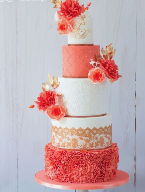 Tired Wedding Cake decorated with coral coloured flowers