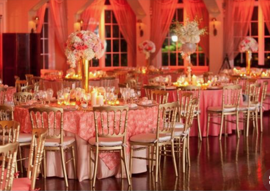 Tables and chairs in living coral colour at wedding venue